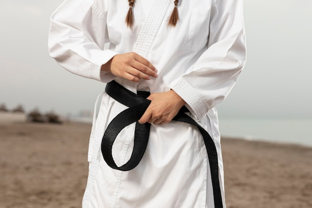 Fit athlete in martial arts costume