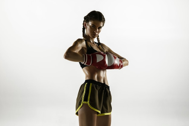 Fit caucasian woman in sportswear boxing isolated on white background