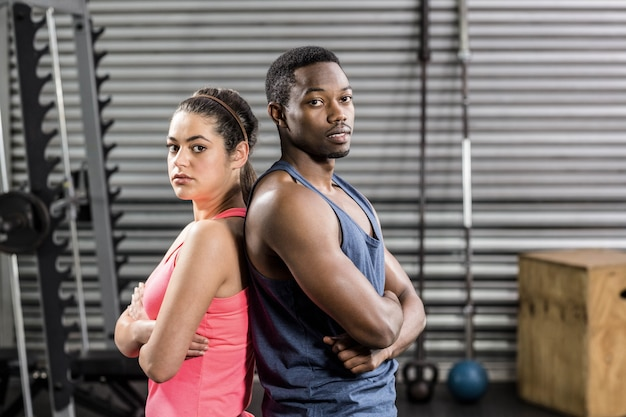 Fit couple back to back at crossfit gym