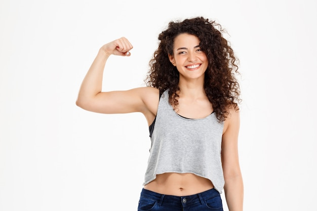 Fit curly girl doing fitness exercises