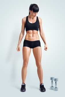 Fit female athlete in activewear ready to doing exercise