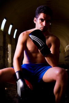 Fit fighter with boxing gloves