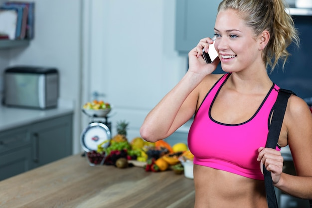 Fit girl calling someone in the kitchen