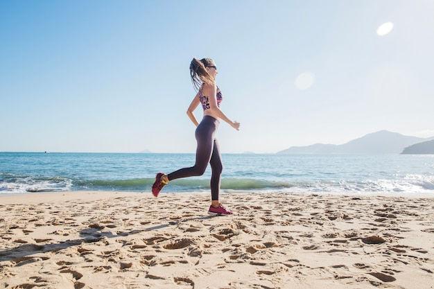 Fit girl during training on the beach