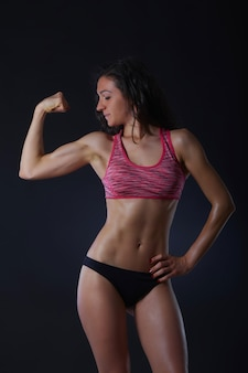 Fit girl shot in studio background
