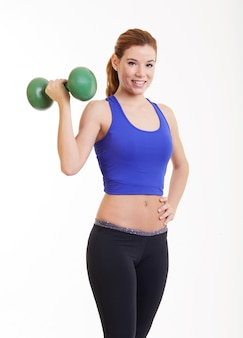 Fit girl with dumbbells