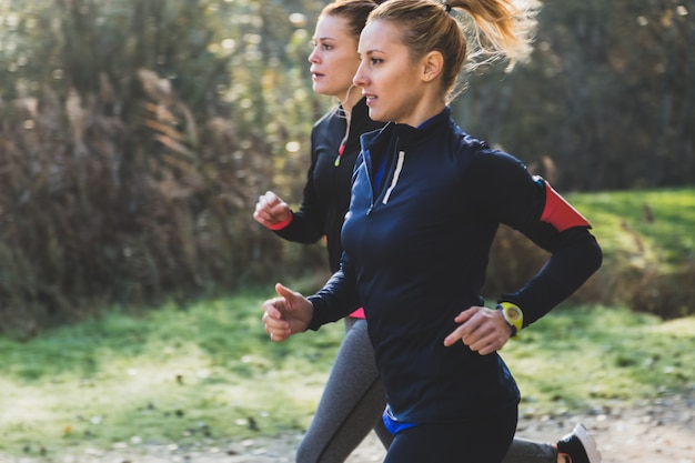 Fit girls running in the park