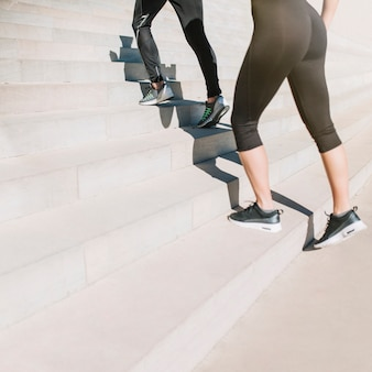 Fit girls walking up stairs