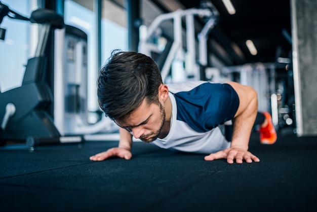 Fit man doing push-ups.