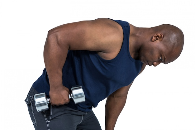 Fit man lifting heavy dumbbells on white background