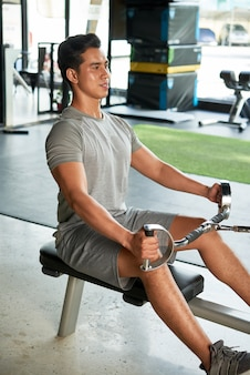 Fit man showing exercises