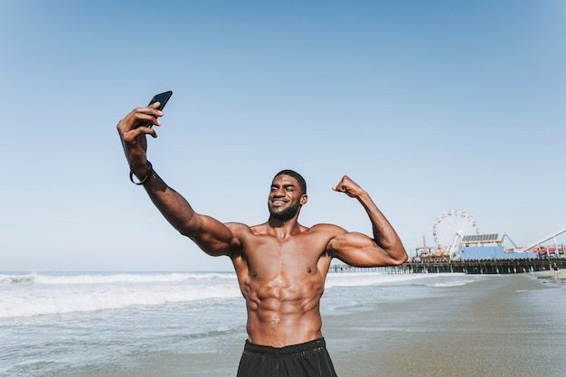 Fit man taking a selfie by santa monica pier