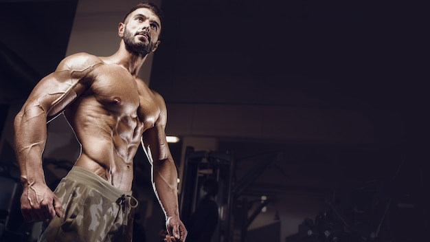 Fit man training training abs muscles at gym. pumping up abdominal exercise