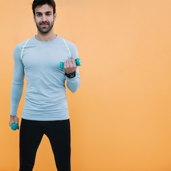 Fit man with dumbbells