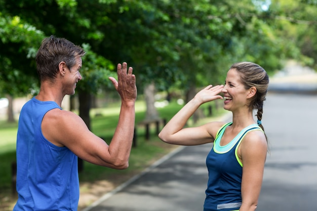 Fit people doing high five