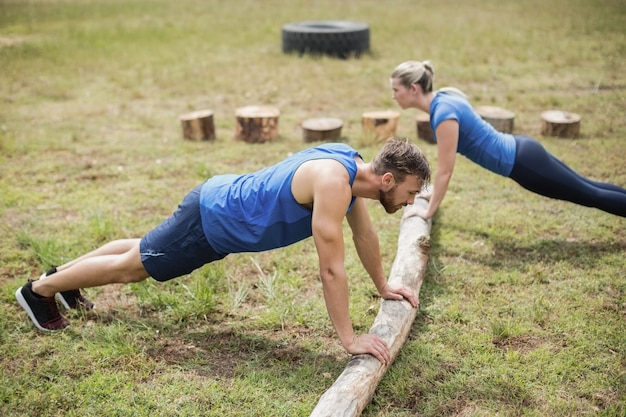 Fit people performing pushup exercise in boot camp