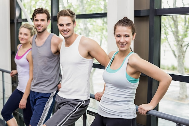 Fit people posing together at crossfit gym