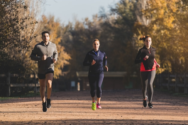 Fit people running outdoors