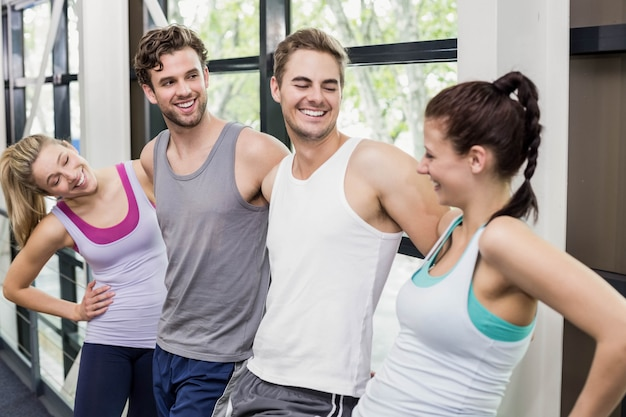 Fit people talking together at crossfit gym