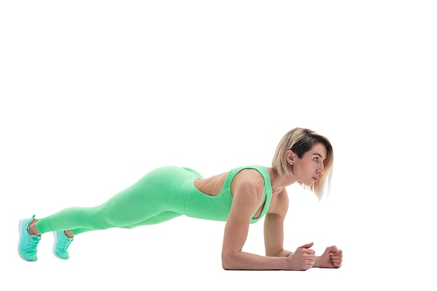 Fit slim woman doing yoga exercise called plank