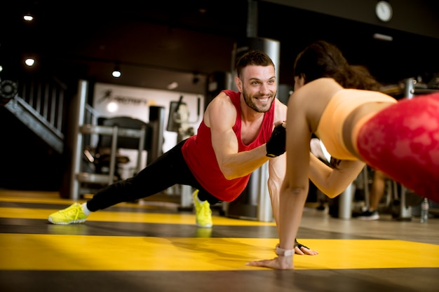 Fit sportive man and woman doing plank core exercise