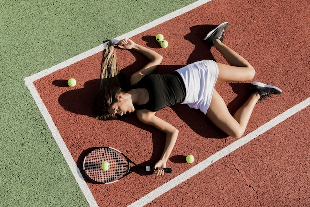 Fit tennis player on the ground