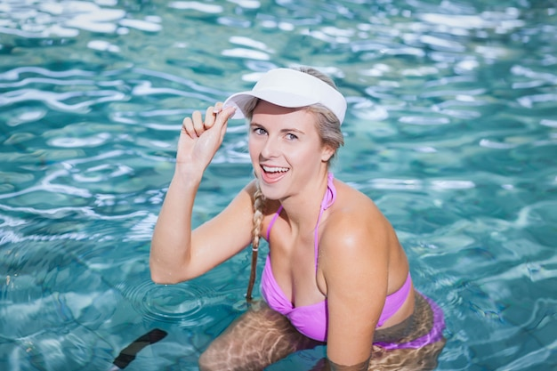 Fit woman doing underwater bike at the pool