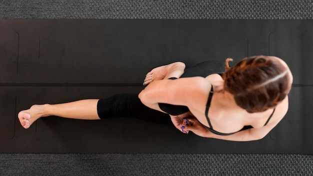 Fit woman doing yoga at home flat lay