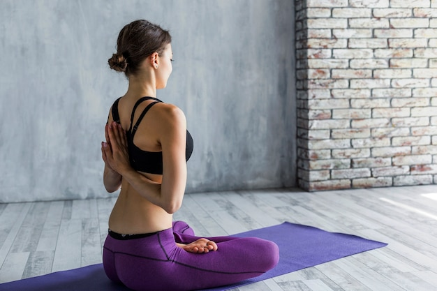 Fit woman meditating