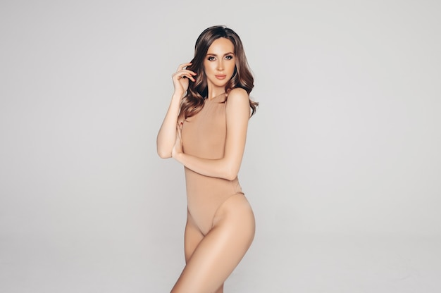 Fit woman in nude lingerie