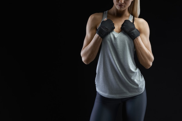 Fit woman's torso with her hands on chest