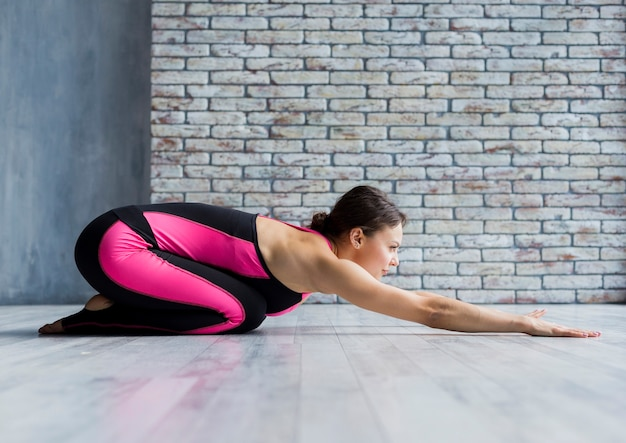 Fit woman stretching forward