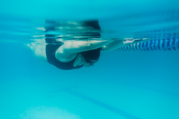 Fit woman swimming underwater