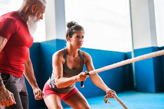 Fit woman with battle rope inside garage