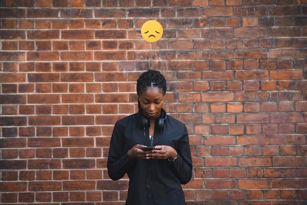 Fit woman with a sad emoji