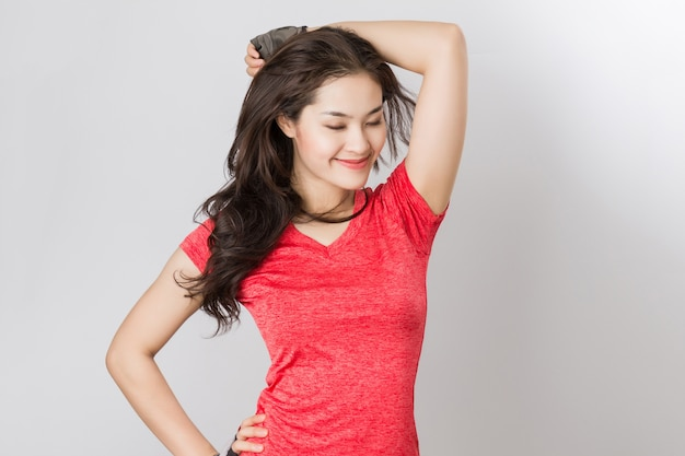 Fit young beautiful healthy asian woman with happy smiley face.