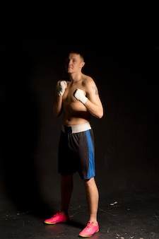 Fit young boxer standing in the ready position