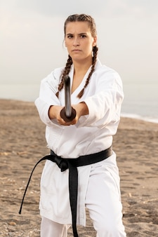 Fit young girl practicing karate