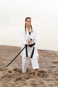 Fit young girl practicing martial art