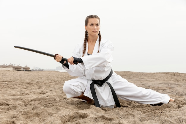 Fit young girl training for karate