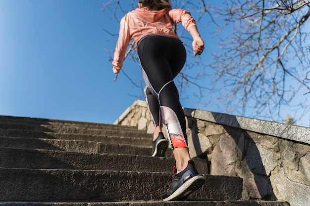 Fit young woman climbing stairs outdoor