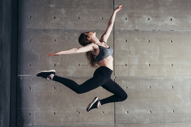 Fit young woman jumping