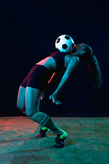 Fit young woman playing football
