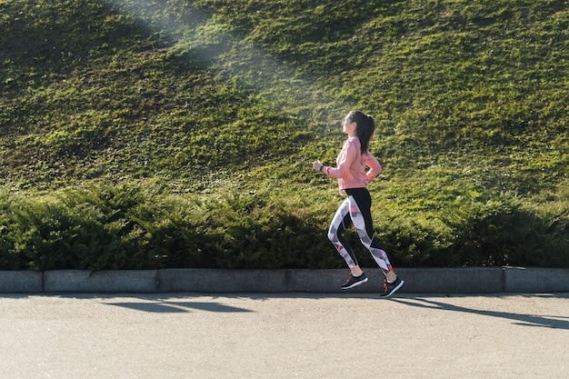 Fit young woman running outdoor