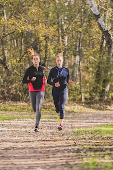 Fit young women running outdoors