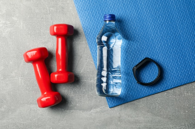 Fitness accessories on gray, top view