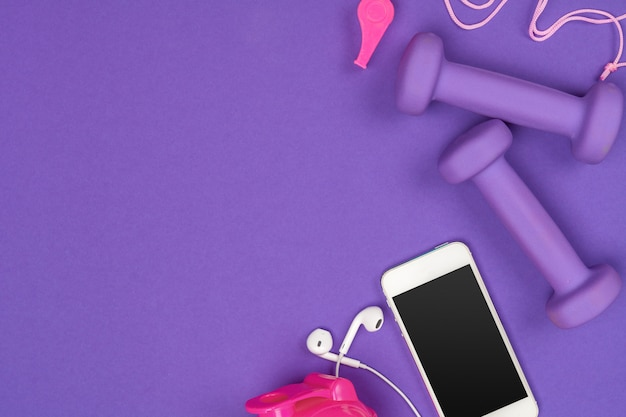 Fitness accessories on purple