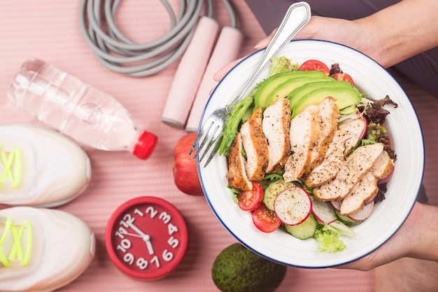 Fitness and active healthy lifestyles concept.a plate of chicken breast salad