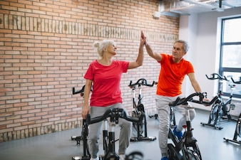 Fitness and teamwork concept with elderly couple