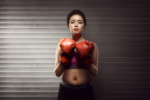 Fitness asian woman with the red boxing gloves